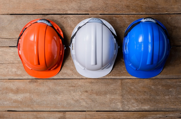 Orange, white and blue protective safety helmet