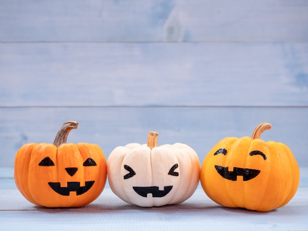 Orange and white pumpkins halloween decorated with faces. use for halloween concept.