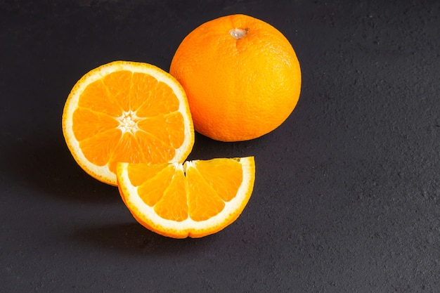 Orange with cut on dark floor.