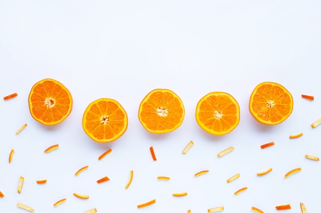Orange with peels on white.