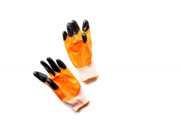 Orange work gloves for construction and repair work on a white background.
