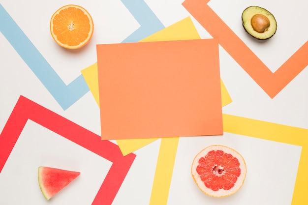 Orange yellow sticky notes and sliced orange avocado grapefruit watermelon