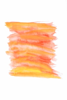 Orange and yellow watercolor brush strokes on white paper