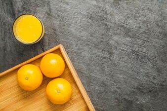 Oranges and juice in arrangement