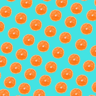 An oranges slices pattern on turquoise background