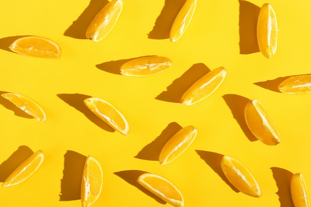 Oranges slices on a yellow background, bright pattern wallpaper.