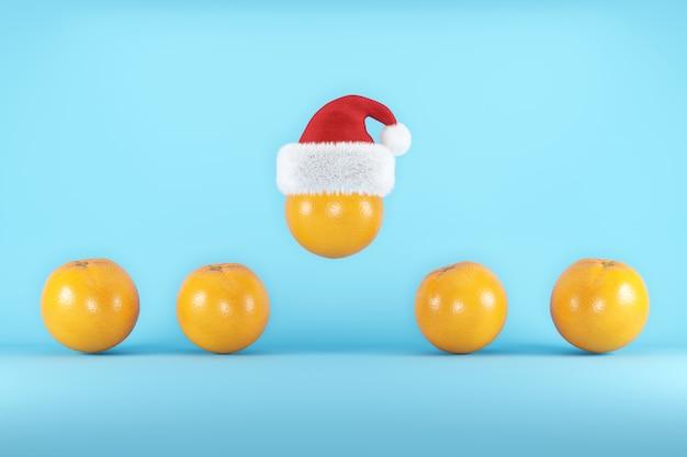 Oranges with santa hat floating on blue