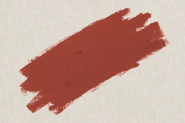 Orangish brown oil paint brush stroke texture on a beige canvas textured