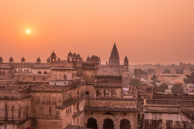 Orchha palace, hindu temple, cityscape at sunset, madhya pradesh. also spelled orcha, famous travel destination in india.