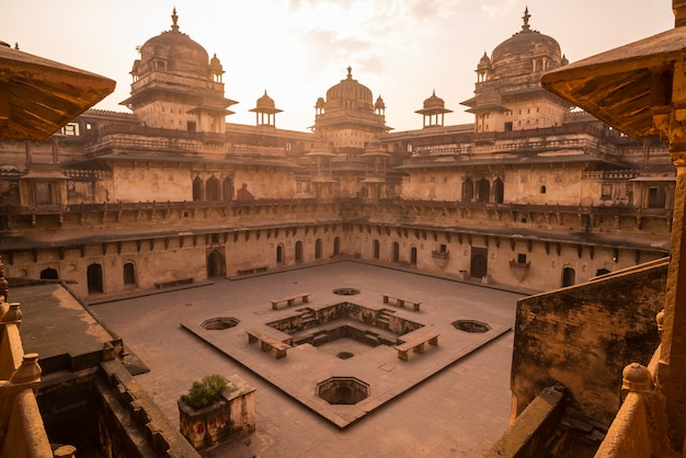Orchha palace, interior with courtyard and stone carvings, backlight.