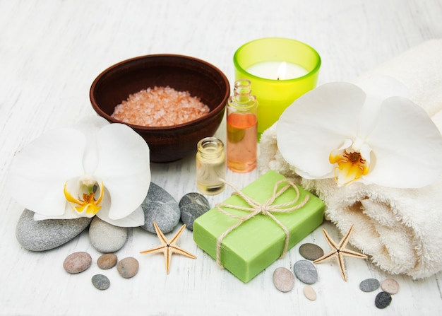 Orchids, candle, towel and handmade soap