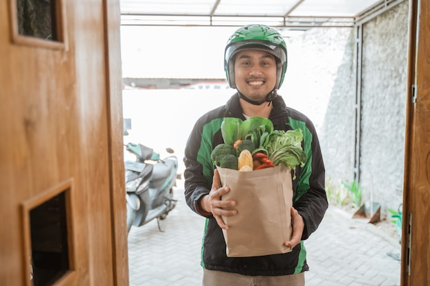 Order online food courier delivering to customer at home