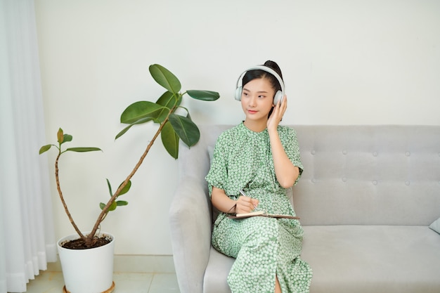 Ordinary female asian teen portrait at home sofa remote education concept.