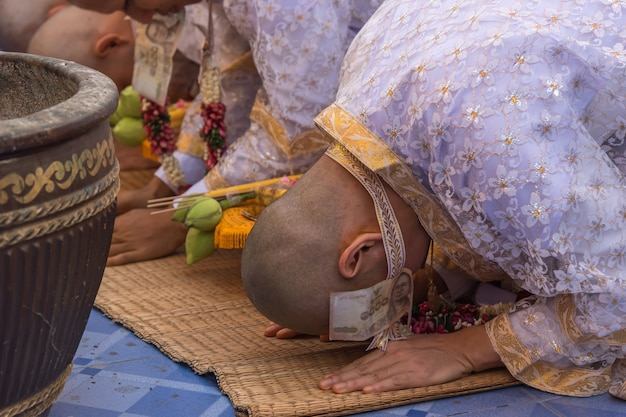 Ordination ceremony in buddhist thai monk ritual for change man