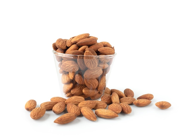 Organic almonds in glass bowl and heap almonds isolated on white