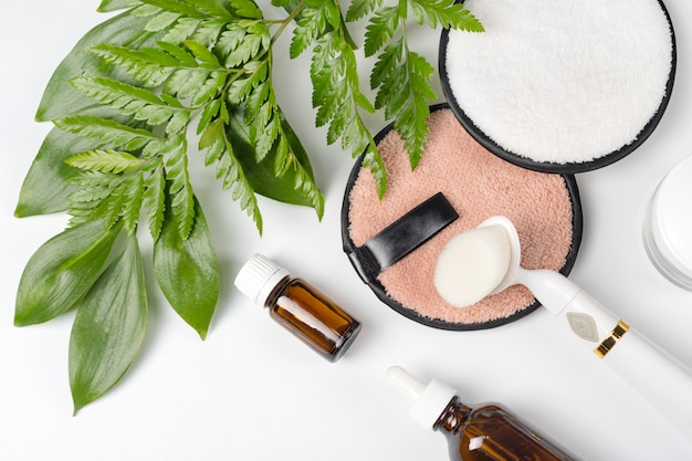 Organic bio cosmetics with herbal ingredients. natural extract, oil, serum with fresh leaves.