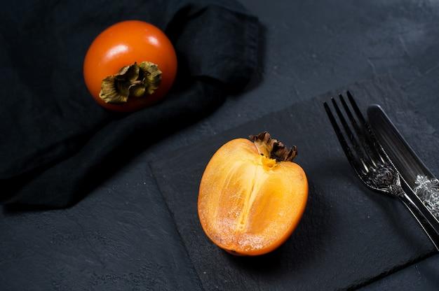 Organic bio persimmon on black.