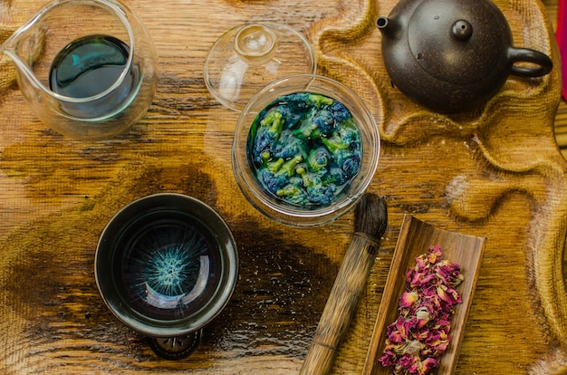 Organic blue tea anchan in a teapot and a cups