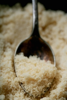 Organic brown sugar in a spoon. close up