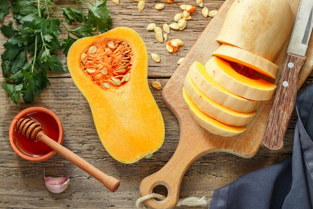 Organic butternut squash with ingredients for cooking