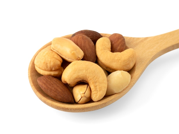 Organic cashew nuts, almond nuts and macadamia nuts and peanut  in wooden spoon isolated on white