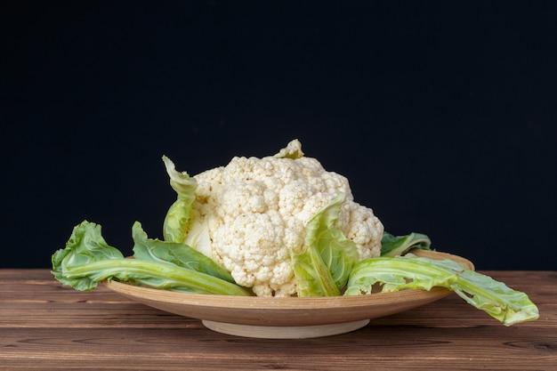 Organic cauliflower on wood