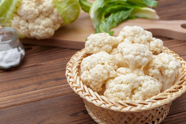 Organic cauliflower on wooden surface