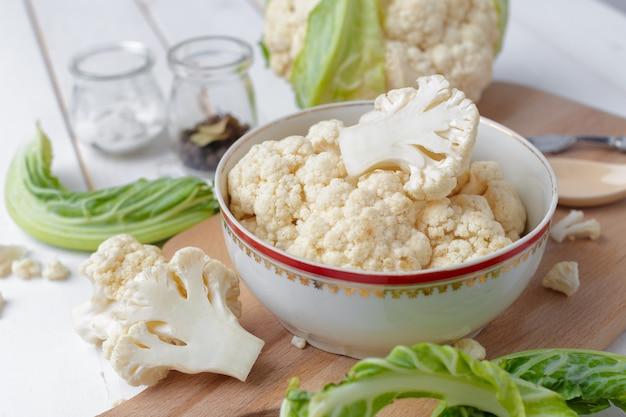 Organic cauliflower on wooden table