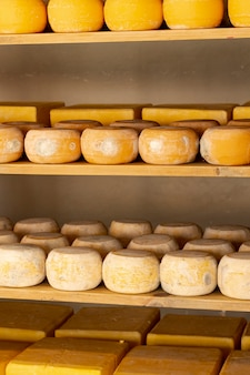 Organic cheese wheels on shelf