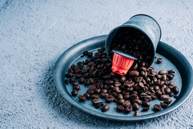 Organic coffee capsule with coffee beans on colorful background. color contrast. copy space