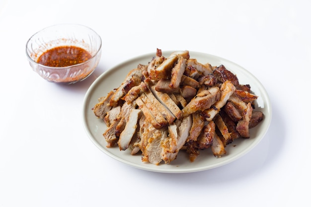 Organic cooked grilled pork chop steak with salt, pepper, garlic and oil in thai style isolated on white