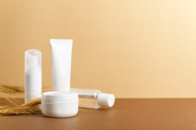 Organic cosmetic white packages with wheat ears composition.