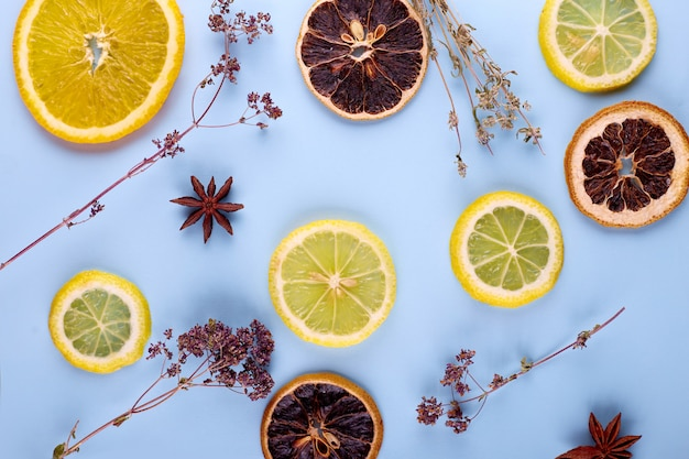 Organic cosmetic with citrus on blue background top view