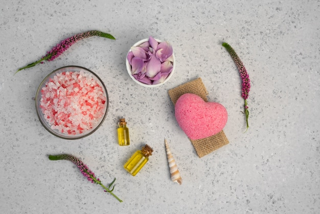 Organic cosmetic with rose oil on grey background