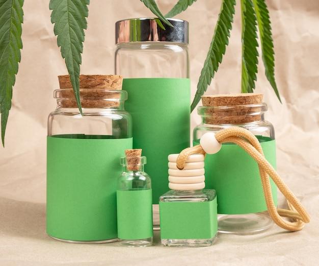 Organic cosmetics based on cannabis green bottles with marijuana leaf