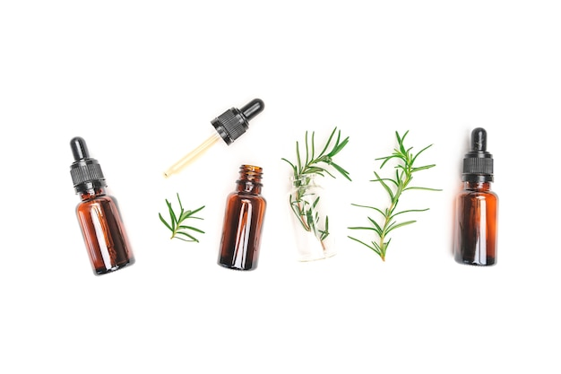 Organic cosmetics with extracts of herbs rosemary on white background