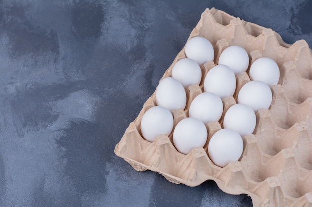 Organic eggs in a cardboard tray