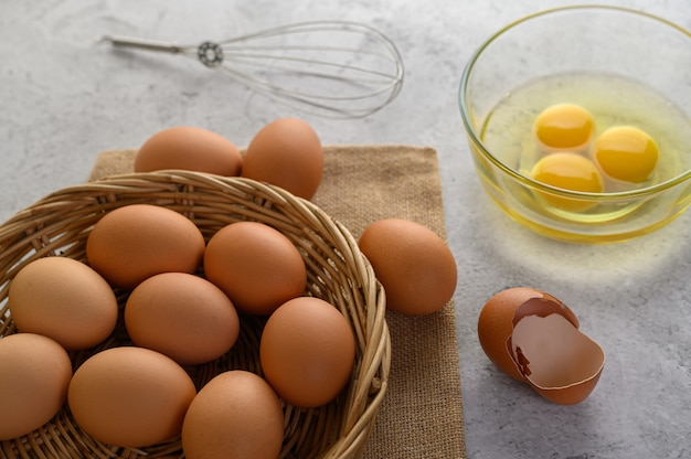 Organic eggs and oil preparing cooking meal