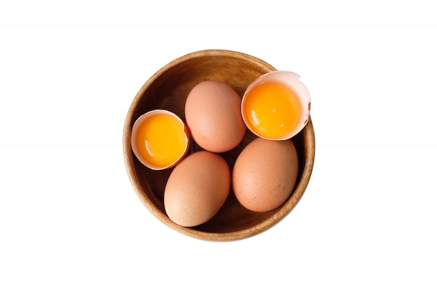 Organic eggs placed in a wooden bow