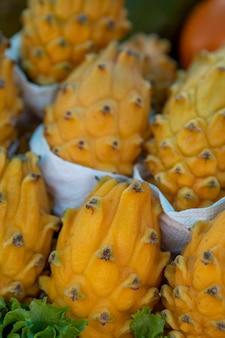 Organic exotic pitahaya or yellow dragon fruits, background