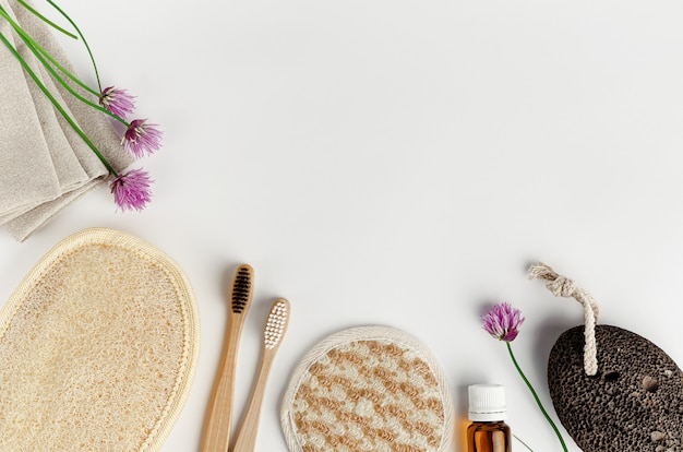 Organic face and body sponges, bamboo toothbrushes and pumice. zero waste bathroom accessories on white background.