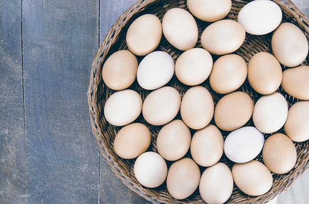Organic farm chicken eggs in the basket from above.copy space for text