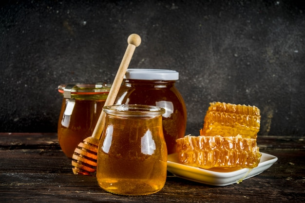 Organic farm honey in jars with honeycombs