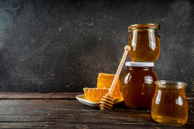 Organic farm honey in jars with honeycombs
