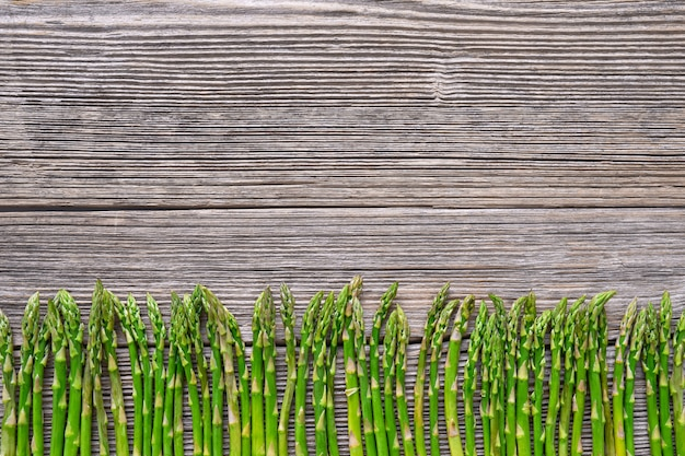 Organic food. asparagus on old wooden background.