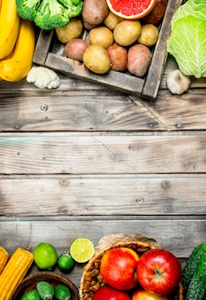 Organic food. fresh fruits and vegetables on a wooden table.