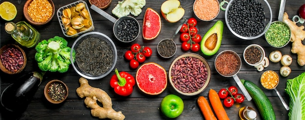 Organic food. fresh vegetables and spices with legumes on rustic table.