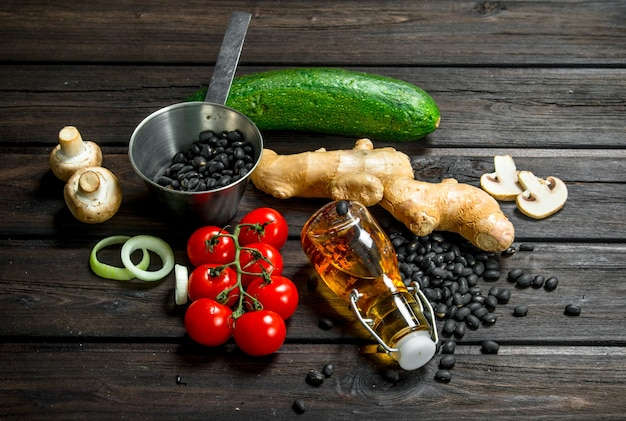 Organic food. fresh vegetables and spices with legumes on wooden table.