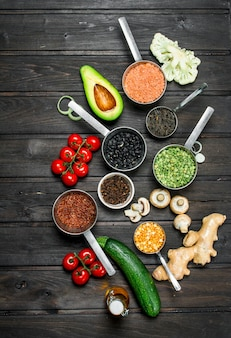 Organic food. fresh vegetables with spices on wooden table.