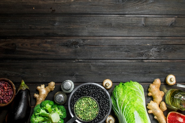 Organic food. healthy assortment of vegetables and fruits with legumes on rustic table.